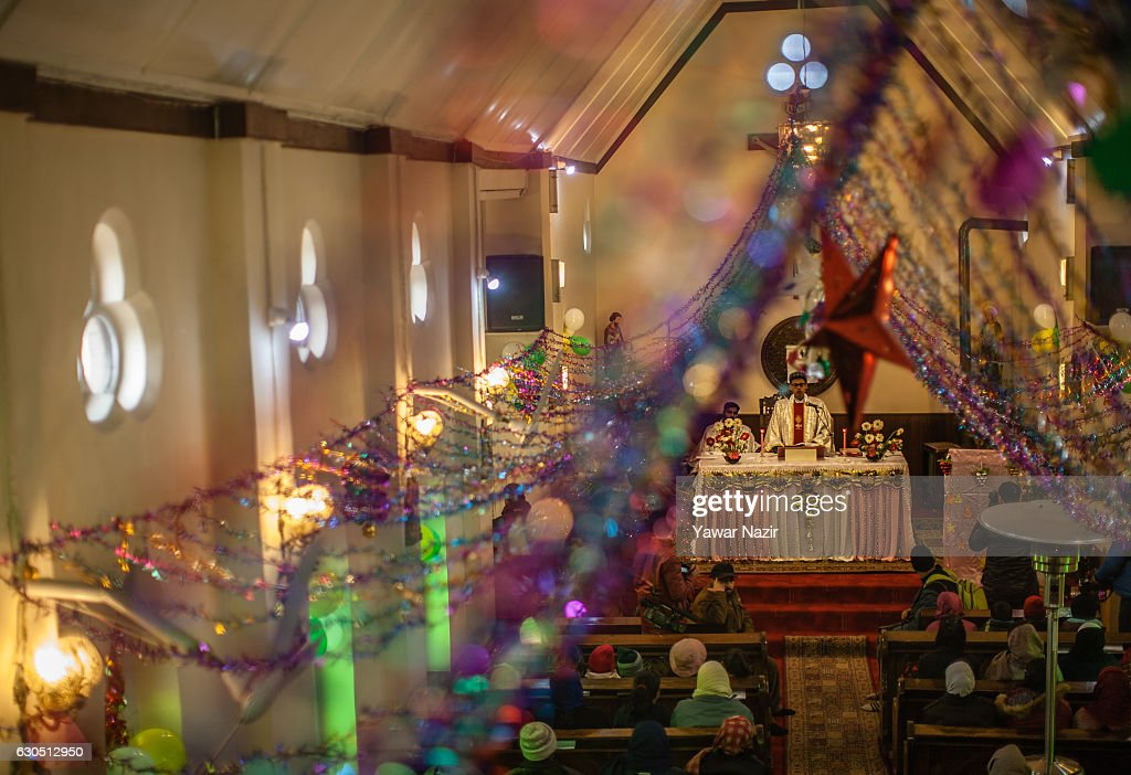 A priest prays in the Holy Family Catholic Church during Christmas on December 25, 2016 in Srinagar, the summer capital of Indian- administered Kashmir. The minuscule Christian population in Kashmir region said it was celebrating Christmas in a low key manner due to the killing of nearly 100 people and blinding of hundreds by Indian government forces to quell the latest anti-India uprising in the Himalayan region following the killing of a popular local militant commander in July this year. They also held special prayers for the people particularly children of Syria and Iraq.