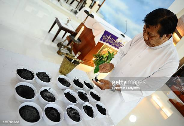 Priest prepares black ashes for the Ash Wednesday ceremony at Roh Kudus Church on March 5 2014 in Surabaya Indonesia Ash Wednesday marks the...