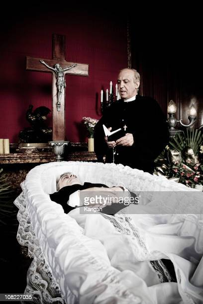 priest presiding over funeral - coffin stock pictures, royalty-free photos & images