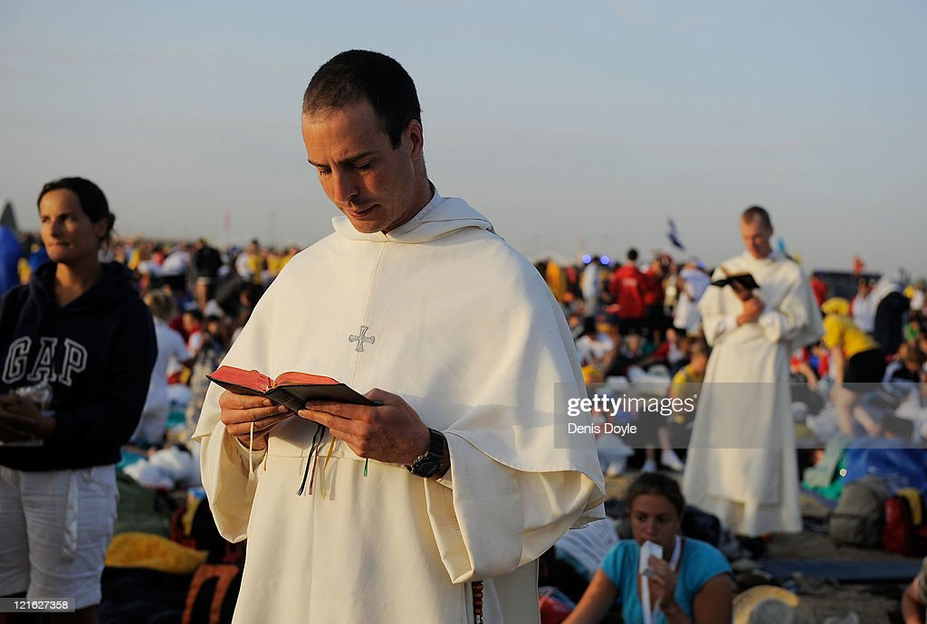A priest preys at the Cuatro Vientos Airport during the World Youth Day closing ceremony on August 21, 2011 in Madrid, Spain. Initiated by Pope John Paul II in 1985, World Youth Day youth-oriented events for the celebration of the Catholic faith are held every three years in a different country; this time in Madrid from August 16th to 21st, with Pope Benedict XVI in attendance.