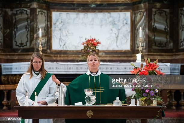 Priest Sandra Signarsdotter and Deacon Ingrid El Qortobi gives the Sunday service at Gustaf Vasa Church in Odenplan, Stockholm on August 23, 2020. -...