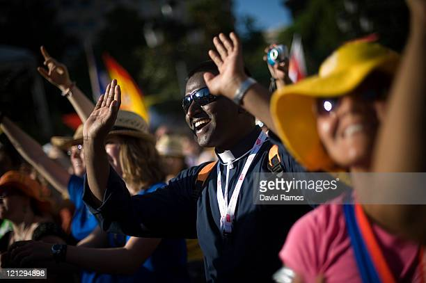 A priest sings during a live concert as part of the World Youth Day 2011 on August 17 2011 in Madrid Spain Initiated by Pope John Paul II in 1985...