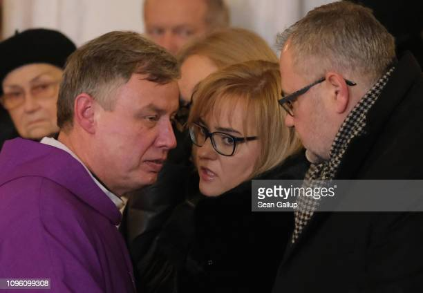 A priest speaks with Magdalena Adamowicz the widow of murdered Gdansk mayor Pawel Adamowicz and his brother Antonina during a Catholic mass in the...