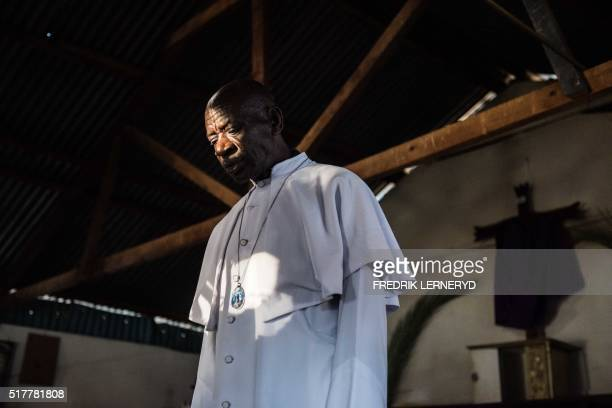 A priest stands in the church building at Kibera slum as members of the Legio Maria African Mission church make a procession marking Good friday in...