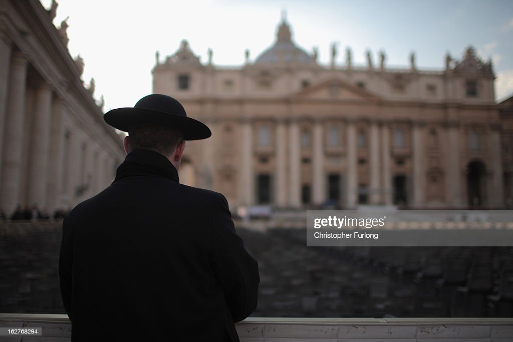 A priest stands next to St Peter's Basilica on February 26, 2013 in Rome, Italy. The Pontiff will hold his last weekly public audience on February 27, 2013 before he retires the following day. Pope Benedict XVI has been the leader of the Catholic Church for eight years and is the first Pope to retire since 1415. He cites ailing health as his reason for retirement and will spend the rest of his life in solitude away from public engagements.