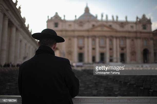 A priest stands next to St Peter's Basilica on February 26 2013 in Rome Italy The Pontiff will hold his last weekly public audience on February 27...