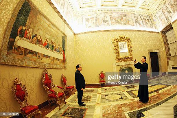 A priest takes a photo during the courtesy visits to the new appointed cardinals at the Apostolic Palace on November 24 2012 in Vatican City Vatican...