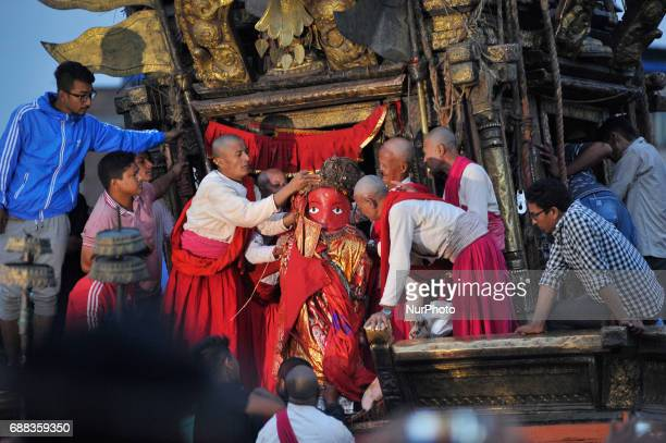 Priest taking out idol Rato Machindranath from the chariot towards the Bungamati after the celebration of Bhoto Jatra festival at Jawalakhel Patan...