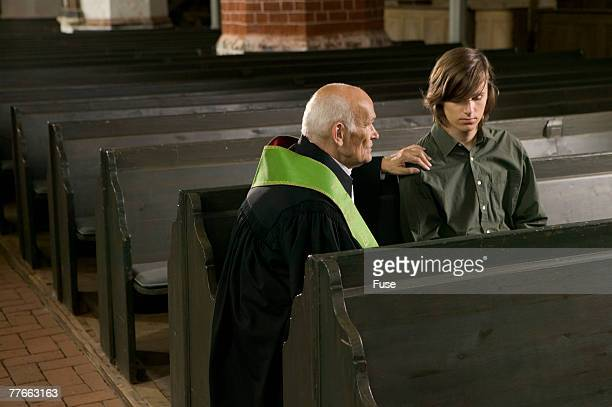 Priest Talking to Young Man