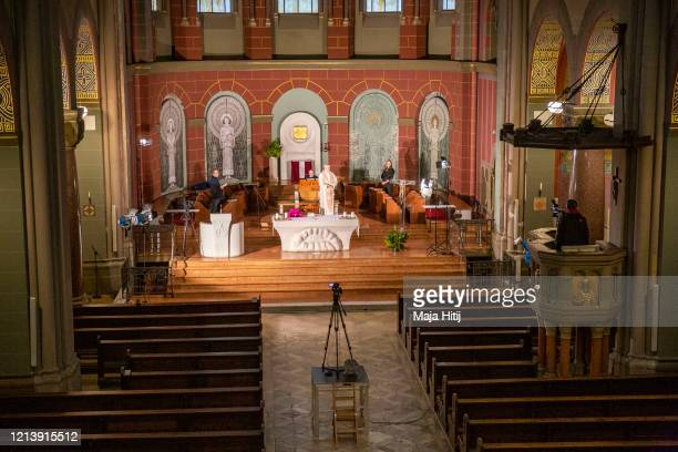 Priest Tobias Przytarski speaks during a rehearsal for the Sunday live streaming of a service on March 21, 2020 at the catholic church St. Joseph in...