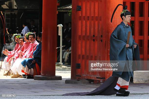 A priest walks to attend the ritual ceremony during the Aoi Festival at Shimogamo Shrine on May 152016 in Kyoto Japan Aoi Festival is one of the...