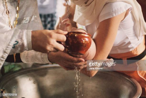 priest watering the baby, baptism - lord bath stock pictures, royalty-free photos & images