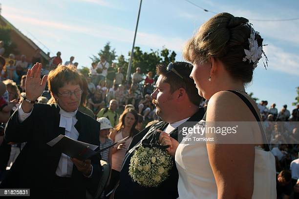 A priest weds a couple at a mass drivein wedding with over 50 couples during Power Big Meet on July 4 2008 in Vasteras Sweden Power Big Meet started...