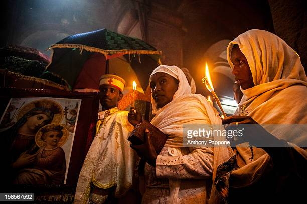 Priests and pilgrims celebrate the fasika in the church Bet Medhame Alem in the night in lalibela, ethiopia.