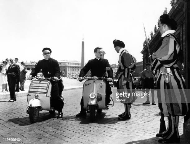 Priests and Swiss guards in vespa. Rome. Italy. 1957.
