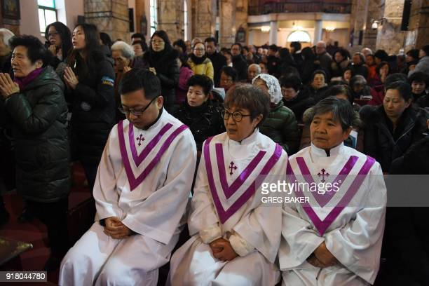 Priests attend an Ash Wednesday mass which marks the beginning of Lent at Beijing's government sanctioned South Cathedral on February 14 2018 China's...