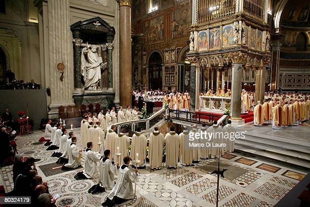 Priests attend the Feet Washing Ceremony celebrated by Pope Benedict XVI at the StJohn in Laterano Basilica on March 20 2008 in Rome Italy Pope...
