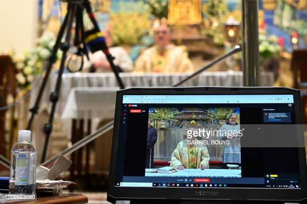 Priests celebrate the Holy Thursday mass behind closed doors but broadcasted on social networks, at the Jesus de Medinaceli Basilica in Madrid, on...