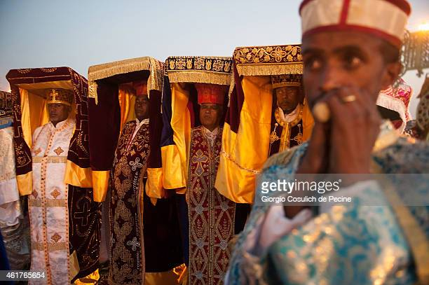 Priests dressed with traditional clothes carry the Tabot over their heads as they attend the Timkat celebration on January 18 2015 in Addis Ababa...