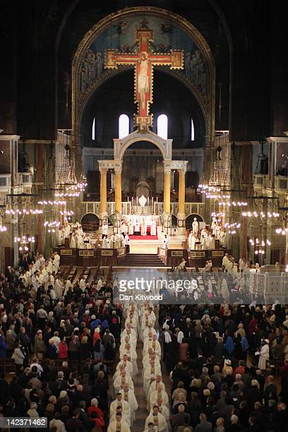Priests file out of Westminster Cathedral after the annual Chrism Mass on April 3 2012 in London England The Archbishop of Westminster Vincent...
