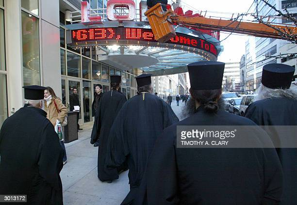 Priests from the Saint Markellas Greek Orthodox Church in Brooklyn New York arrive by bus at the Loews Theater in midtown to attend the first showing...