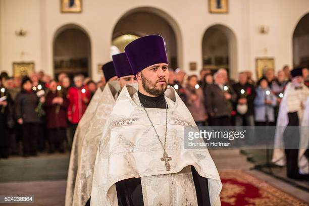 Priests lead a ceremony to commemorate the 30th anniversary of the Chernobyl nuclear accident at St Michael the Archangel Orthodox Church on April 26...