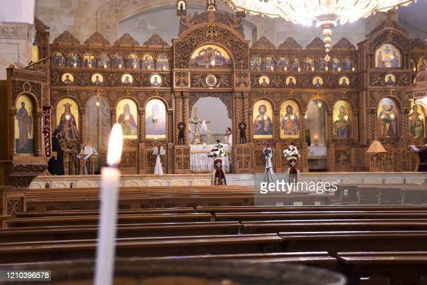 Priests lead a crowdless Easter Sunday mass during a nationwide lockdown to stem the spread of the novel coronavirus at the Prophet Elias Greek...