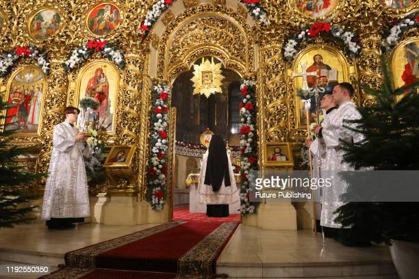 Priests of the Orthodox Church of Ukraine are seen during a Christmas Eve liturgy at the St. Michaels Golden-Domed monastery. - PHOTOGRAPH BY...