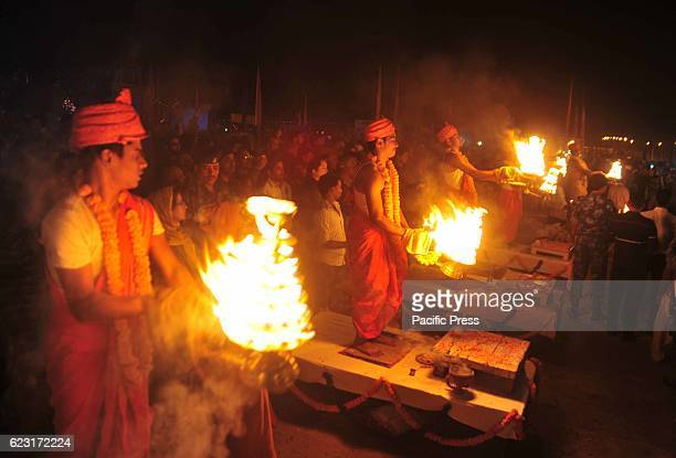 Priests performing arti on the occasion of Kartik Purnima also called Ganga Dussehra festival at Sangam the confluence of River Ganga Yamuna and...