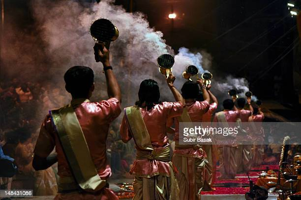 priests performs arti ritual at varanasi,india - ceremony stock pictures, royalty-free photos & images