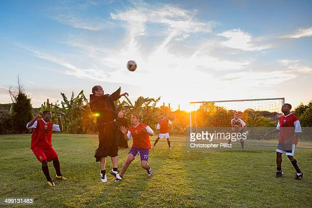 Priests playing football, Brazil