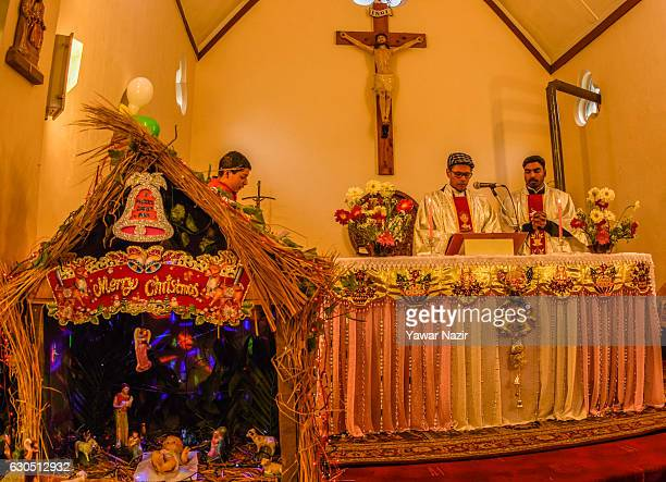 Priests pray in the Holy Family Catholic Church during Christmas on December 25 2016 in Srinagar the summer capital of Indian administered Kashmir...