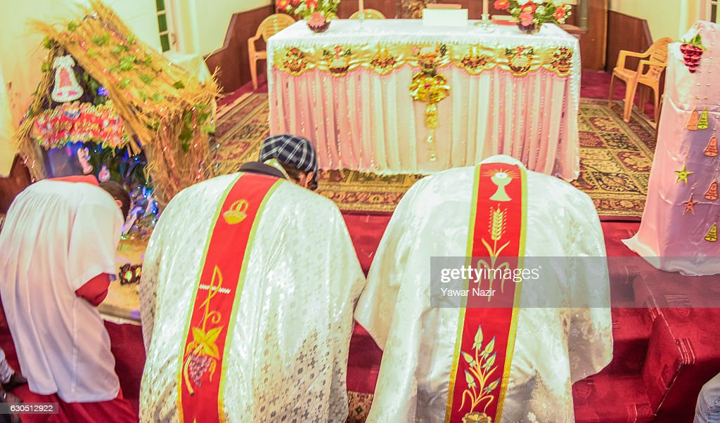 Priests pray inside the Holy Family Catholic Church during Christmas on December 25, 2016 in Srinagar, the summer capital of Indian- administered Kashmir. The minuscule Christian population in Kashmir region said it was celebrating Christmas in a low key manner due to the killing of nearly 100 people and blinding of hundreds by Indian government forces to quell the latest anti-India uprising in the Himalayan region following the killing of a popular local militant commander in July this year. They also held special prayers for the people particularly children of Syria and Iraq.