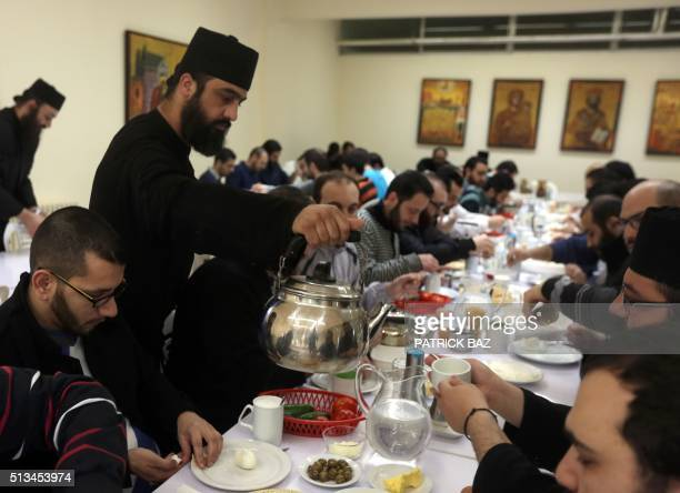 Priests serve breakfast to students at the Greek Orthodox Saint John of Damascus Institute of Theology in Balamand in northern Lebanon on March 3...