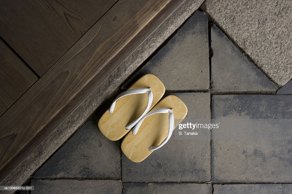Priest's slippers on stone tiles, close-up : Foto stock