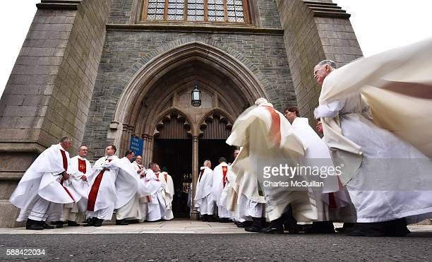 Priests stand in procession for the funeral of the late retired Bishop of Derry Dr Edward Daly as he lies in state at St Eugene's Cathedral on August...