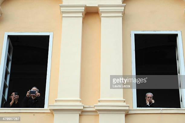 Priests take photos before the wedding of Italian singer Andrea Bocelli with Veronica Berti at Sanctuary of Madonna di Montenero on March 21 2014 in...