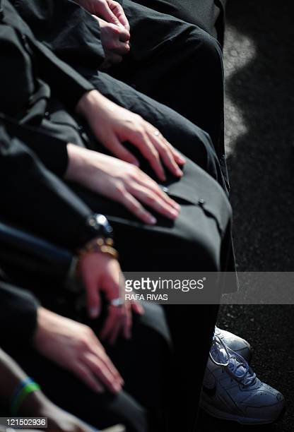 Priests wait for the arrival of Pope Benedict XVI at the Almudena Cathedral to celebrate a mass during the World Youth Day festivities in Madrid on...