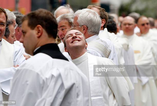 Priests wait outside St Patrick's Cathedral for a procession of catholic clergy before the Installation Mass for Archbishop Timothy Dolan at St...
