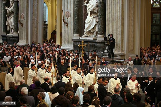 Priests walk in procession during the Feet Washing Ceremony celebrated by Pope Benedict XVI at the StJohn in Laterano Basilica on March 20 2008 in...