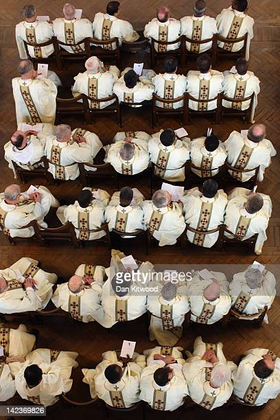 Priests wear their new clerical vestments during the annual Chrism Mass in Westminster Cathedral on April 3 2012 in London England The Archbishop of...