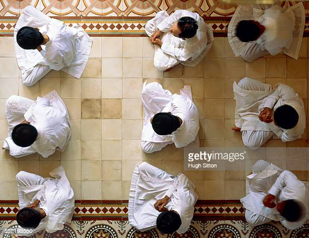 priests worshipping on tiled floor - hugh sitton stockfoto's en -beelden