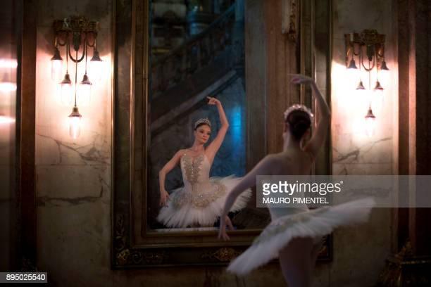 Prima Ballerina Deborah Ribeiro prepares to perform in front of Rio de Janeiro's Municipal Theater during a protest demanding unpaid salaries and...