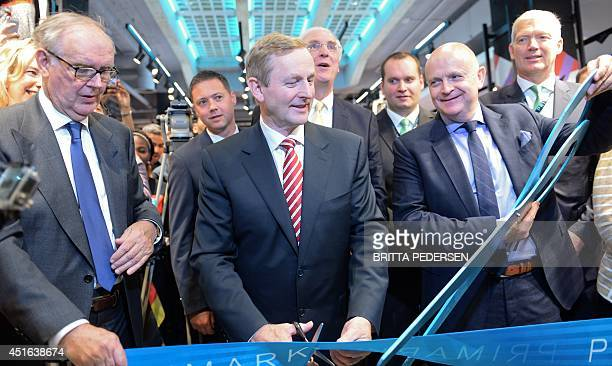 Primark Chairman Arthur Ryan Irish Prime Minister Enda Kenny and Primark CEO Paul Marchant cut the rubbon to open a Primark clothes retailer store at...