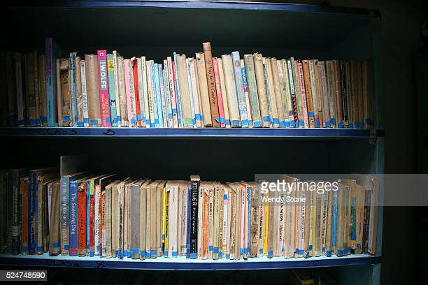 Primary and secondary school books on the shelves in the library at KICOSHEP the Kibera Community Self Help Program a grass roots organization that...