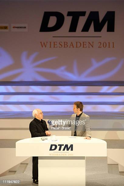 Primary Chairman of the DTM Hans Werner Aufrecht speaks to ARD Anchorman Claus Lufen at the press conference on April 10, 2011 in Wiesbaden, Germany.