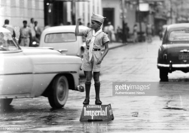 A primary school boy assists local policemen in directing traffic in San Jose Costa Rica