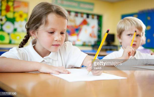 primary school: children concentrating on schoolwork.