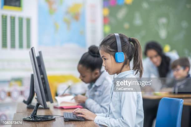 Primary school girls working on computers