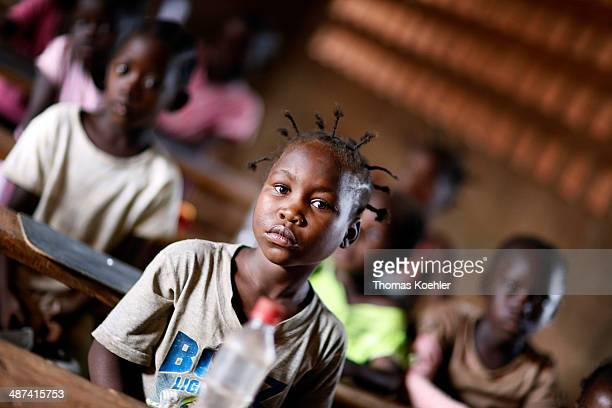 A primary school pupil with braided hair in the front seat in a classroom at a primary school in the capital city of Bangui Central African Republic...